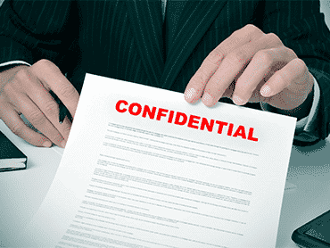 man holding up confidential bad credit loan agreement