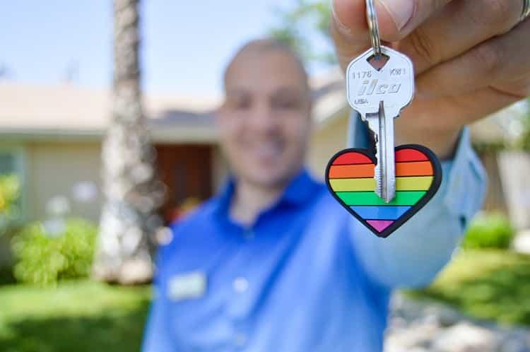 car title loan man handing holding car keys